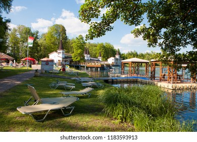 Heviz, Hungary - May 26, 2017: The beach of Heviz spa. Lake Heviz is the 2nd largest natural thermal lake in the world.
