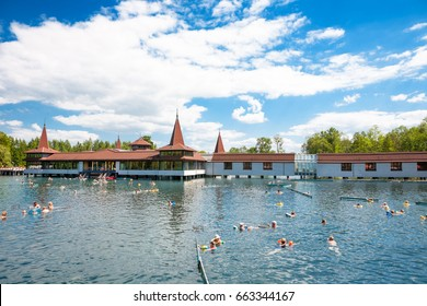 Heviz, Hungary - May 26, 2017: Lots of people bathing in Heviz Spa. Lake Heviz is the 2nd largest natural thermal lake in the world.