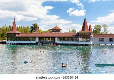 Heviz, Hungary - May 26, 2017: Bathers in  Heviz Spa. Lake Heviz is the 2nd largest natural thermal lake in the world.