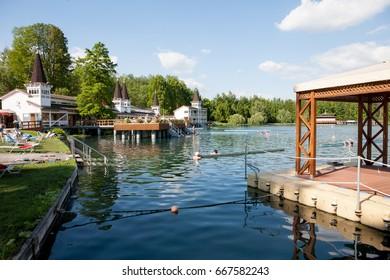 Heviz, Hungary - May 26, 2017: Heviz Lake beach. Lake Heviz is the 2nd largest natural thermal lake in the world.