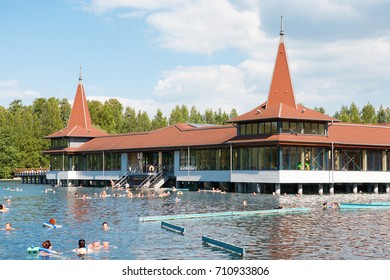 Heviz, Hungary - May 26, 2017: The Heviz Spa with bathers in Hungary. Lake Heviz is the 2nd largest natural thermal lake in the world.