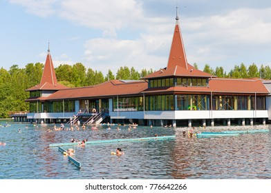 Heviz, Hungary - May 26, 2017: Bathers enyojing the warm water lake of Heviz Spa. Lake Heviz is the 2nd largest natural thermal lake in the world.