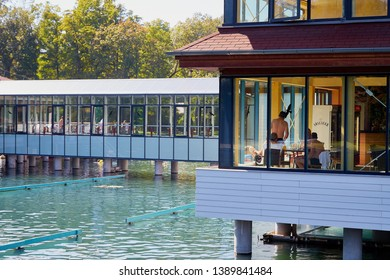Heviz, Hungary - September 27, 2018: Pontoon with tourists on therapeutic lake Heviz in Hungary with warm water during all time of a year