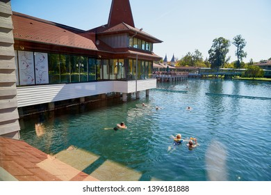 Heviz, Hungary - September 27, 2018: People on a warm water of therapeutic lake Heviz in Hungary in a sunny day