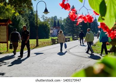 Heviz, Hungary - September 27, 2018: Park in Heviz city near lake Heviz and pepople in it on a Sunny summer day in Hungary