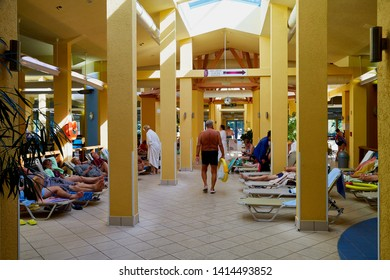 Heviz, Hungary - September 27, 2018: Hall and tourists inside the building on therapeutic lake Heviz in Hungary having hot water during all time of a year