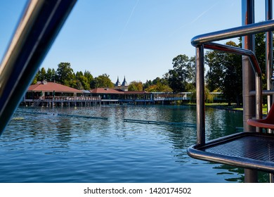 Heviz, Hungary - September 27, 2018: Ladder with railing on alneological therapeutic lake Heviz in Hungary with warm water during all time of a year