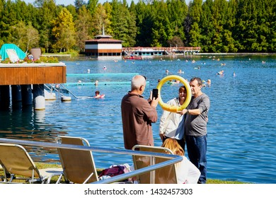 Heviz, Hungary - September 27, 2018: Turists on the beach of balneological therapeutic lake Heviz in Hungary with warm water during all time of a year