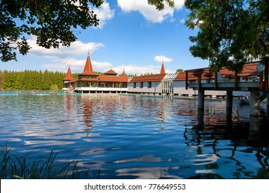 Heviz Lake and spa framed by green foliage in Hungary