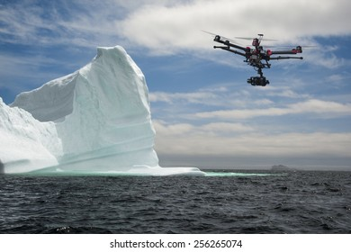 A hexacopter drone with a camera is flying arround an iceberg