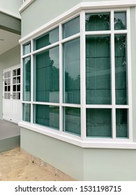 hexagon front window of a green house use green tinted glass (heat absorbing glass) with white frame