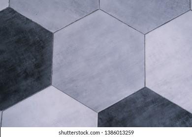 Hexagonal tiles in black and light gray colors. Floor texture from above, flooring, modern minimal interior design