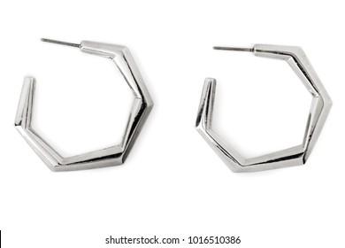Hexagonal-shaped Silver Hoop Earrings isolated on white.