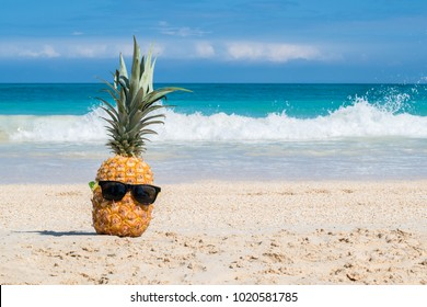 Hey girl, You a Fine-apple: Tropical pineapple chillin on a beach with sunglasses representing hawaiian vacation concept