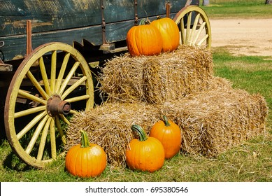 Hey And Pumpkins in Autumn Near an Old Wagon