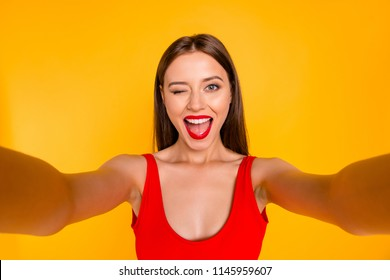 Hey there! Closeup portrait of beautiful pretty charming rejoicing joking cute beautiful stunning funky funny comedian comic lady taking making selfie isolated bright background