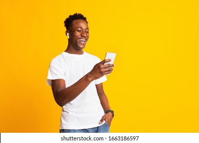 Hey there. Young cheerful afro guy having video call on orange background, copy space - Shutterstock ID 1663186597