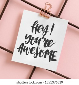 Hey you are awesome. Card with quote hanging on a mudboard