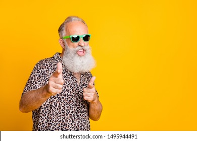 Hey you! Portrait of funky old bearded man in eyeglasses eyewear  feel cool crazy point at you  wearing leopard shirt isolated over yellow background - Shutterstock ID 1495944491