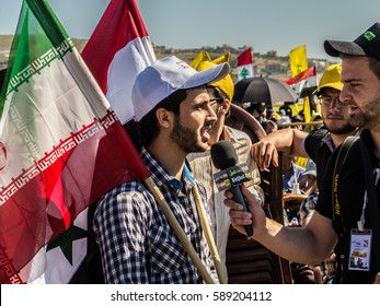 Hezbollah's supporter interviewed at Liberation Day (Bint Jbeil, 25 May 2014)