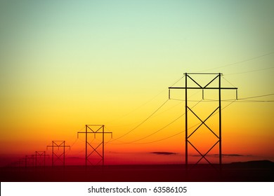 H-Frame Electrical Poles Silhouette at Daybreak