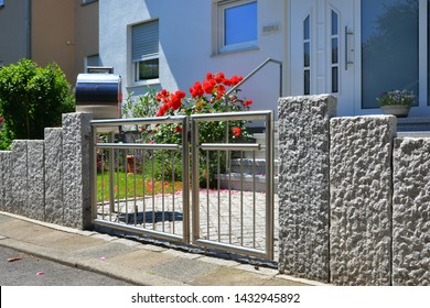 h-Grade Steel in a Granite Stone Garden Wall along the Road in Front of a residential Building