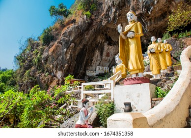 HHA-AN, MYANMAR, BURMA - MARCH 2016: Amazing view of lot Buddhas statues and religious carving on limestone rock in sacred Kaw Goon cave.