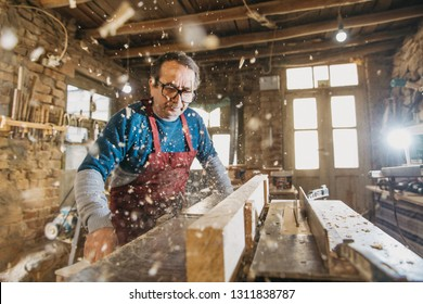 Hhot of old master carpenter working in his woodwork or workshop. DETAILS
