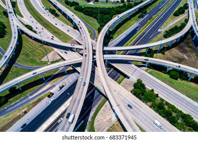 Hi above highways and interchanges the roads band and the interstate takes you on a fast transportation highway in Austin Texas drone view looking down from above