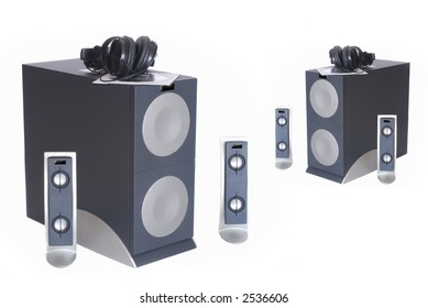 Hi end computer Subwoofer satellite speaker system and headphone, white background.  Quality, electronics concept.