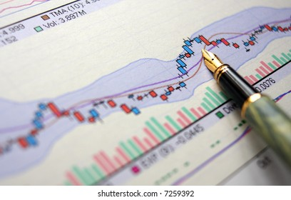 Hi res photo of financial stat with pen
