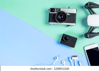 Hi tech travel gadget and accessories on blue and green copy space
