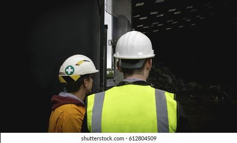 Hi Vis Workers Checking Work