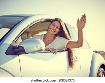 Hi - Young driver Woman Waving out of her new car, rental car.