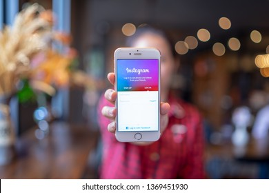 HIANG MAI, THAILAND - Apr.08,2019: Man holding iPhone with Instagram application on the screen. Instagram is a popular online social networking service.