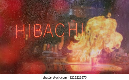 Hibachi Neon Sign With Chef in Background, Blur Rainy Window Image