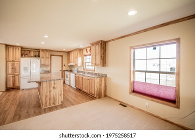 Hickory cabinets make the kitchen warm and happy