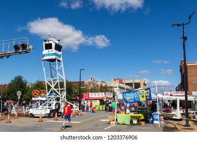 HICKORY, NC, USA-10/14/18: The police watchtower stands over crowds at a small town fall festival.