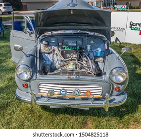 HICKORY, NC, USA-7 SEPT 2019: 1959 Morris Traveler automobile, grey, woodie (woody). Image shows front with engine compartment open.