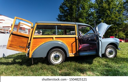 HICKORY, NC, USA-7 SEPT 2019: 1959 Morris Minor 1000 Traveler automobile, grey, woodie (woody). Image shows passenger side with passenger and rear cargo doors open.