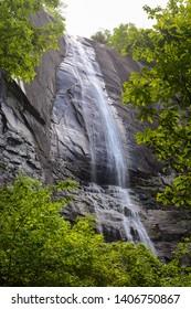 Hickory Nut Falls framed by spring foliage at Chimney Rock State Park in North Carolina