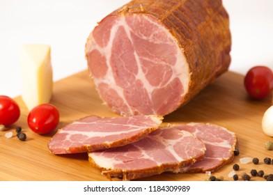 Hickory smoked sliced pork ham stuffed in a net - Dimljeni suvi svinjski vrat