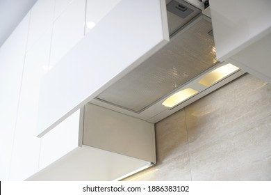Hidden built-in hood. Kitchen cooker hood with filter. Home range hood in kitchen furniture. Forced ventilation to clean the kitchen from odors.