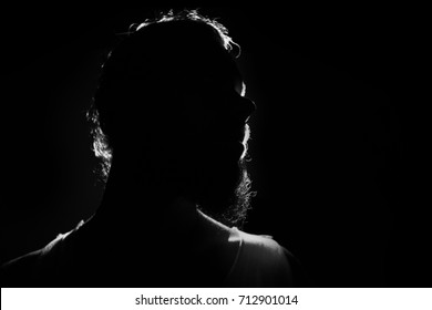 Hidden face in the shadow. bearded male person silhouette
