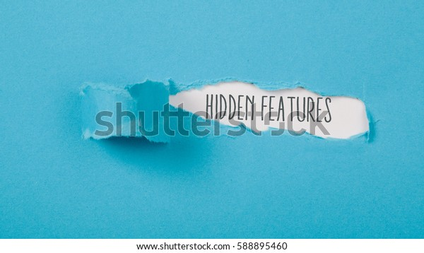 Hidden Features message on torn blue paper revealing secret behind ripped opening.