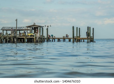 Hidden Florida Destinations. Old Fishing Pier In One Of Florida's Secluded areas In Lee County On The Gulf Of Mexico Coast Of South West Florida. A Real Gem Of A Place.