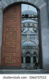 A hidden gem of Islamic architecture. Sultan Ahmed Mosque in Istanbul as seen through a vintage door.