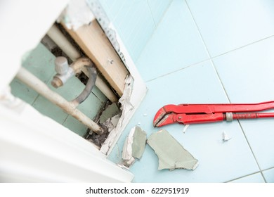 Hidden leaks in heating or watter supply can cause rot and other damage if left untreated. DIY, plumbing, water leak, home repair concept photo.