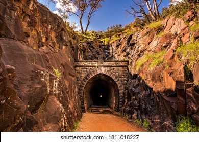 Hidden old train tunnel at national park with rock formation valley