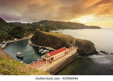 a hidden shelter port on a sunset mountain
